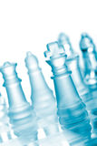 Glass chess. Set on chess board Royalty Free Stock Images