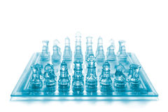 Glass chess. Set on chess board isolated on white background Royalty Free Stock Photography