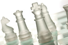 Glass chess. On chess board Stock Photo