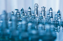 Glass chess. In blue with shallow depth of field Royalty Free Stock Photo