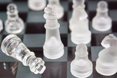 Glass chess on a black background. Concept of victory. Top view Royalty Free Stock Photo