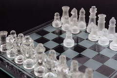 Glass chess on a black background. Stock Photography