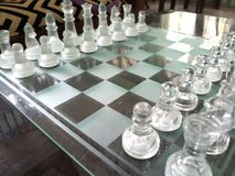 Glass chess board arranged ready-to-play. royalty free stock photos