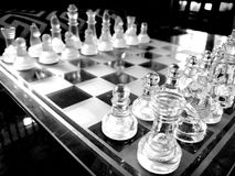 Glass chess board arranged ready-to-play. stock images