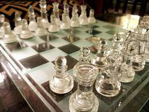 Glass chess board arranged ready-to-play. royalty free stock images