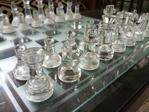 Glass chess board arranged ready-to-play. stock photos