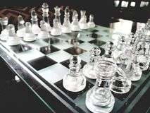 Glass chess board arranged ready-to-play. stock photography