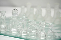 Glass Chess board with Clear and Frosted Pieces. Glass Chess board Macro with Clear and Frosted Pieces royalty free stock photography