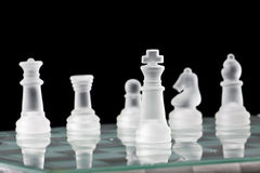 Glass Chess Board and Pieces Royalty Free Stock Photography