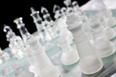 Glass Chess Board and Pieces Royalty Free Stock Photos
