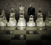 Glass chess board - We are puppets, Businessman of the king on the chessboard Royalty Free Stock Photography