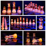 Glass chess on a chessboard lit by a blue and orange light Stock Photos
