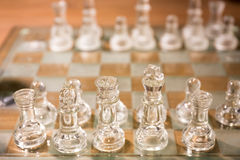 Glass Chess and chessboard Stock Image