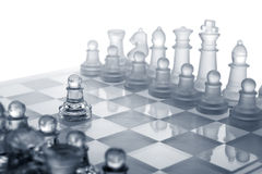 Glass chess. The first move. Stock Photography