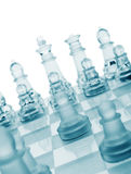 Glass chess. The first move. Royalty Free Stock Images