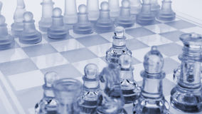 Glass chess. The first move. Royalty Free Stock Photography