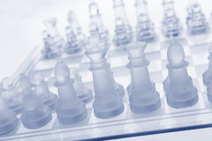 Glass chess. The first move. Royalty Free Stock Photos