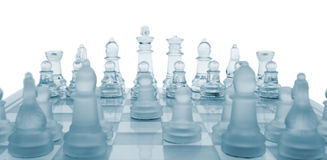 Glass chess. The first move. Royalty Free Stock Image