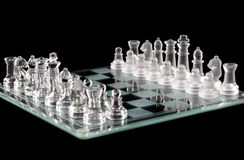 Glass chess over black Stock Photo