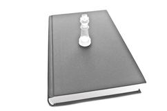 Glass Chess Piece On Book Royalty Free Stock Photography