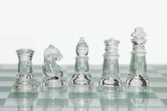 Glass chess pieces Royalty Free Stock Image