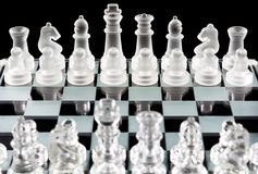 Glass chess pieces Stock Image