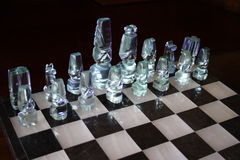 Glass chess pieces Royalty Free Stock Photo