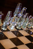 Glass Chess pieces. Attractive designer Chess pieces made of glass on marble board with black background Stock Photography