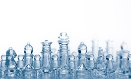Glass chess pieces with blue light Stock Image