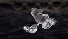 Glass chess pieces,broken horse Stock Photo