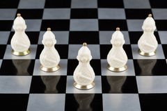 Glass chess pieces on a chessboard Stock Image