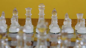 Glass Chess Pieces Set Up On Board. Glass Chess Men In Starting Positions On Board Camera Moving stock video
