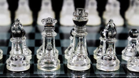 Glass Chess Pieces Set Up In Starting Locations On Board Royalty Free Stock Photography