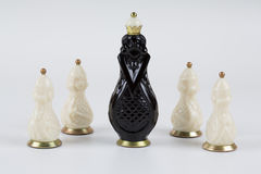 Glass chess pieces on a white background Stock Image