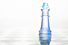 Glass chess queen Stock Images