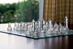 Glass chess set Stock Images