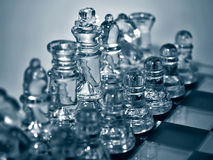 Glass Chess Set. Glass chess pieces are arranged and ready to fight Royalty Free Stock Photography