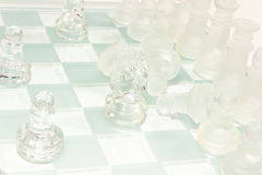 Glass chess set. Transparent glass chess isolated on white Stock Image