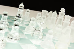 Glass chess set. Transparent glass chess isolated on white Stock Photos