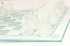 Glass chess set. Transparent glass chess  on white Royalty Free Stock Images