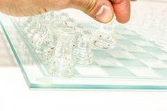 Glass chess set. Transparent glass chess  on white Royalty Free Stock Photo