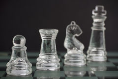 Glass chess team: king, pawn, knight and rook Royalty Free Stock Images