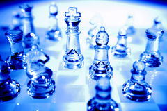 Glass chessboard and pieces Stock Image