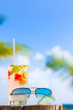 Glass of chilled cocktail mohito and sunglasses on Royalty Free Stock Photo