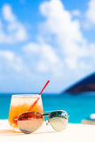 Glass of chilled cocktail rum punch and sunglasses Stock Images