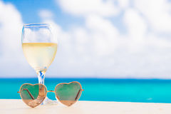 Glass of chilled white wine on table near the stock photography