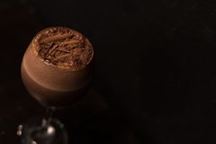 Glass of chocolate or coffee cocktail  in low-key lighting. Very creamy and delicious  chocolate or coffee cocktail or mocktail with dark background in low-key Royalty Free Stock Images