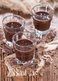 Glass with Chocolate Liqueur Stock Photography