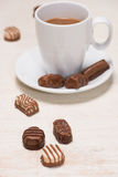 Glass of chocolate milk and variety chocolates  on table Royalty Free Stock Photos