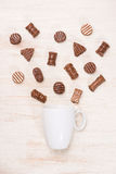 Glass of chocolate milk and variety chocolates  on table Royalty Free Stock Photography